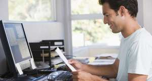 bigstock-Man-In-Home-Office-Using-Compu-4133309-900x480